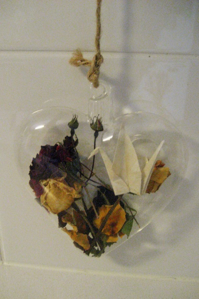 Heart of glass with rose bouquet & peace crane