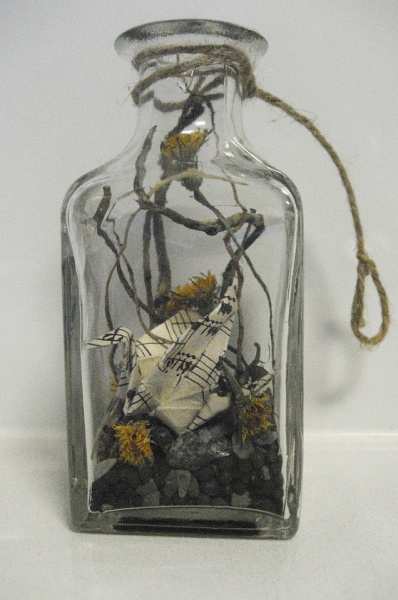 Vintage sheet music crane and flowers in bottle