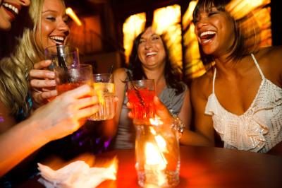 Two Woman Enjoying a Drink in a Club.