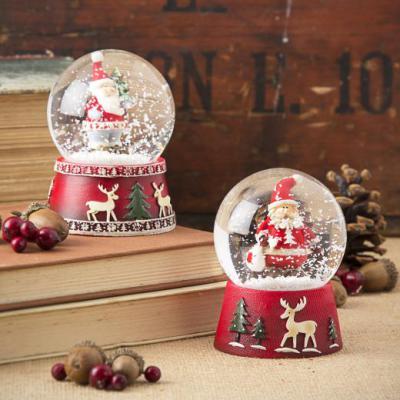 The Contemporary Home - Santa Snow Globe