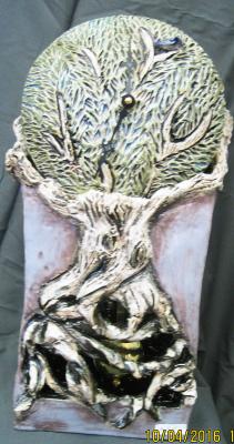 Tree of life sculpture with pendulum