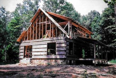 Log cabins, log homes, custom sawn log home packages
