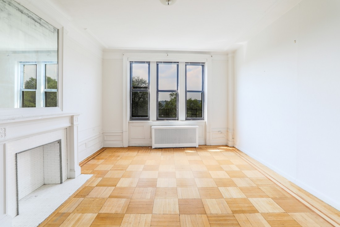 Decorate fireplace, hardwood floors and high ceilings provide great bones for your dream home!