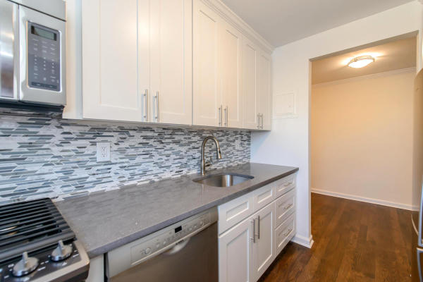 Beatiful kitchen with custom white shaker style cabinets and granite countertops