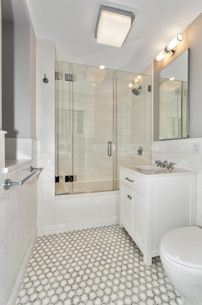 Guest bathroom with marble tiles and Waterworks fixtures