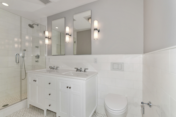 En-suite marble master bathroom with double vanity and Waterworks fixtures