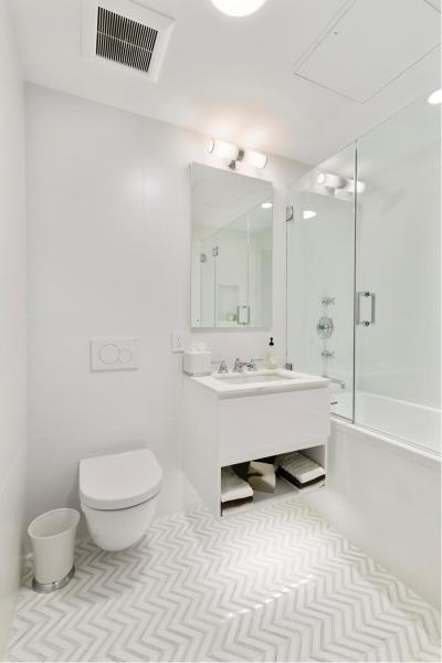 Stunning master bath with Carrara marble tiles and Waterworks fixtures