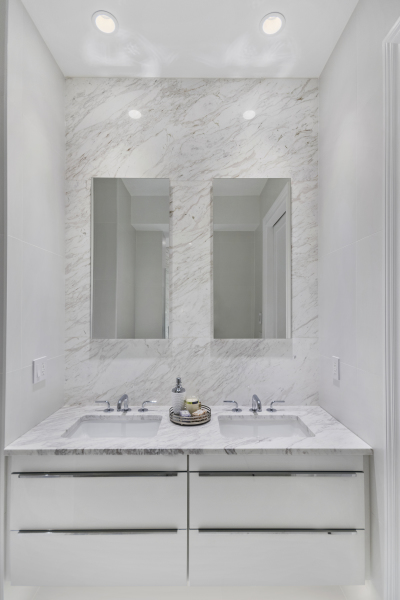 MASTER BATHROOM DOUBLE VANITY WITH MARBLE FEATURE WALL