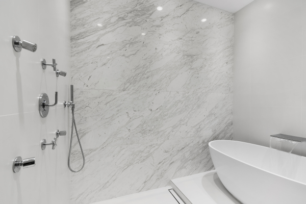 "MASTER BATHROOM ""WET ROOM"" WITH MARBLE FEATURE WALL AND SEPARATE TUB"