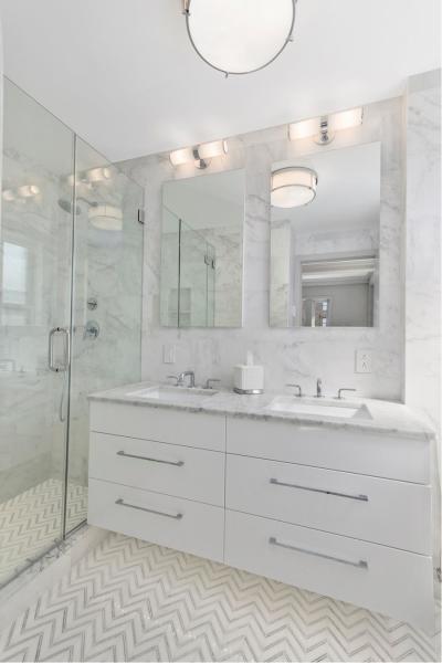 Marble master bathroom with double vanity, in-floor heating and Waterworks fixtures