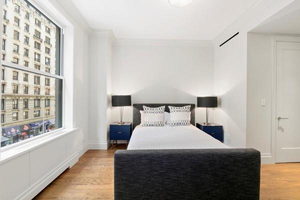 2nd Bedroom with custom closet and en-suite marble bathroom