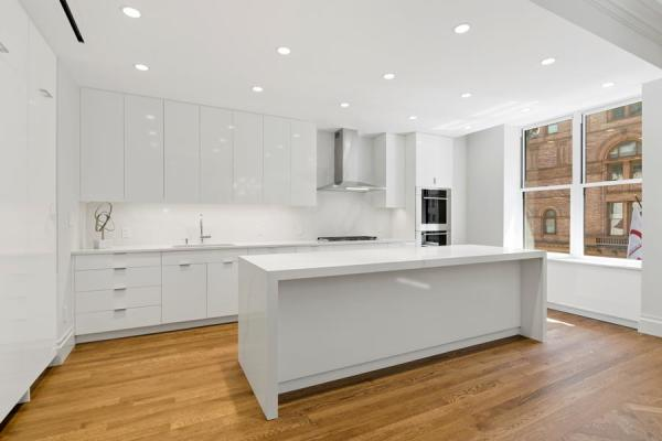 Custom high gloss kitchen with 10 foot island and Subzero and Viking appliances