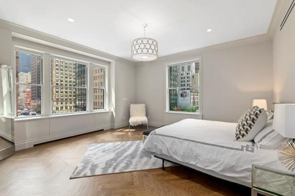 Master bedroom with double exposures, a custom walk-in-closet and en-suite bathroom