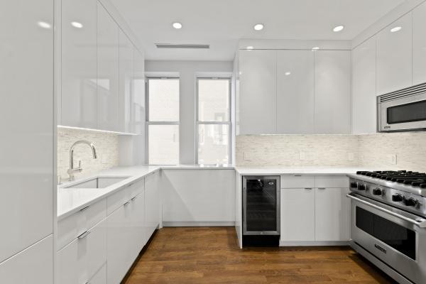 Custom high gloss kitchen featuring Calacatta Marble