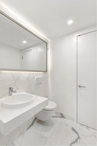 Powder Room tiled with Porcelanosa Kala White Nature
