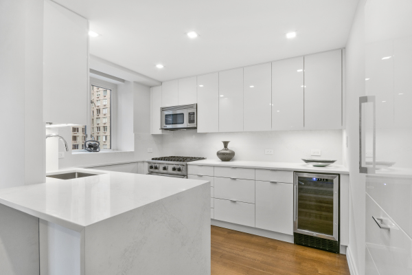 Custom Brookhaven high gloss kitchen with integarated Subzero and Viking appliances as well as a winecooler
