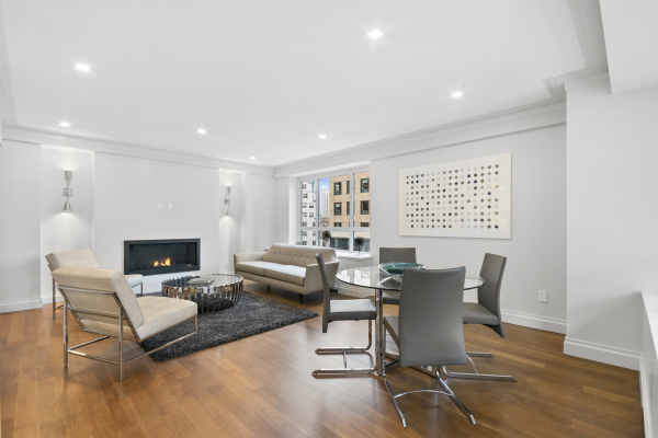 Open concept dining room/living room with working fireplace