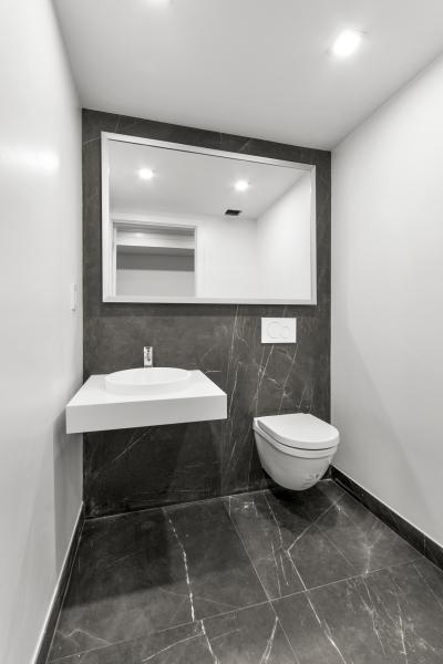 Powder Room with Porcelanosa Dark Nature tiles