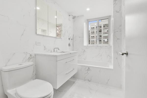 Master Bathroom with Porcelanosa Carrara Blanco tiles and Waterworks fixtures