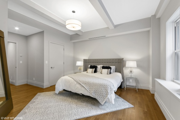 Master bedroom with 2 custom closets, 1 of which is a walk-in-closet, and an en-suite bathroom