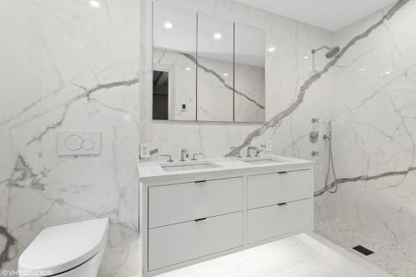 En-suite master bathroom with Kala White Porcelanosa slabs, Waterworks fixtures and in-floor heating