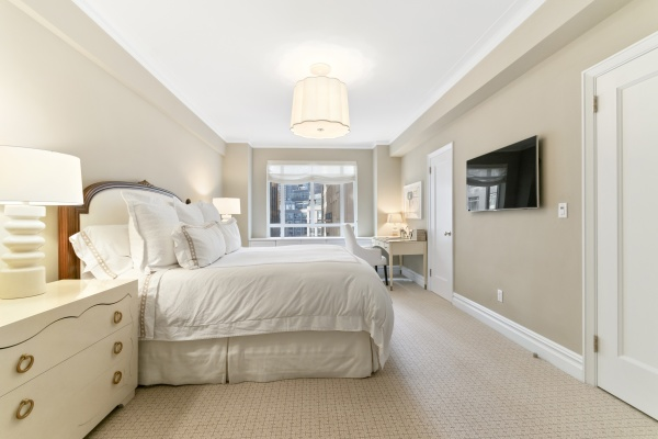 Master Bedroom featuring 3 custom closets and an en-suite marble bathroom