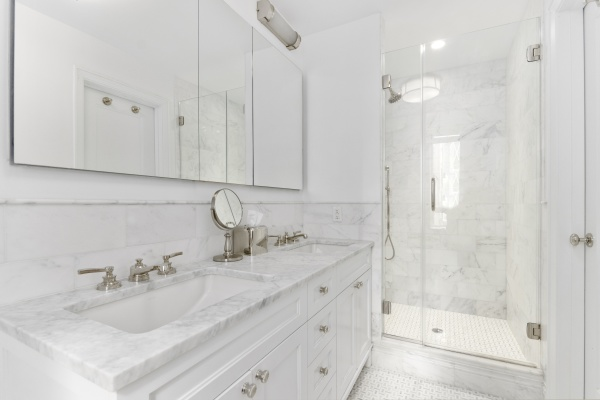 Master Bathroom featuring his and her sinks, Waterworks fixtures and marble countertops and tile