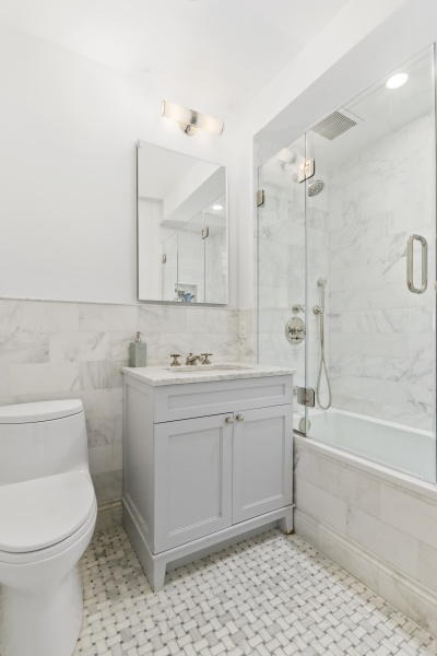 Guest Bathroom featuring marble countertops and tile