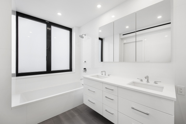 Guest Bathroom with double vanity and beautiful Porcelanosa tiles.