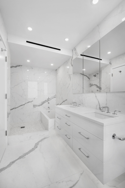 Master Bathroom retreat with double vanity, large shower, separate tub, heated floors, and Porcelanosa slabs