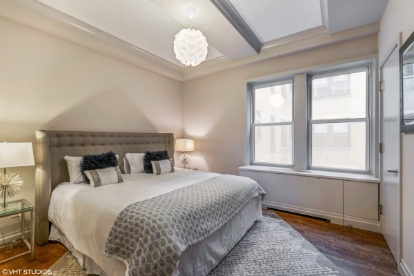 King-size master bedroom with 2 custom walk-in-closets