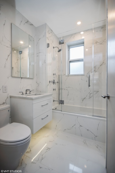 Fully redone bathroom with Porcelanosa Marmol Carrara tiles and Waterworks fixtures