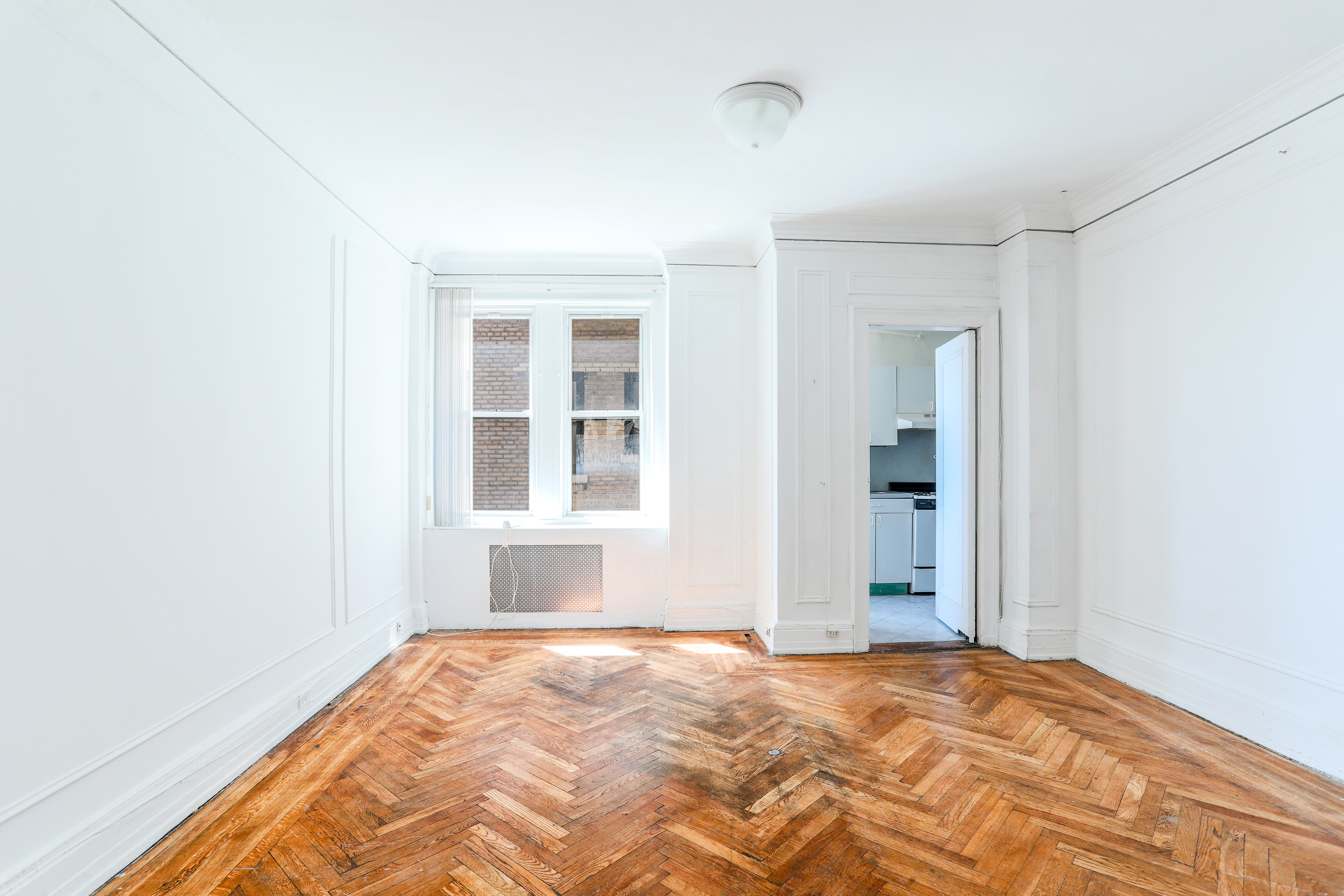 Formal dining room with herringbone floors and South exposures