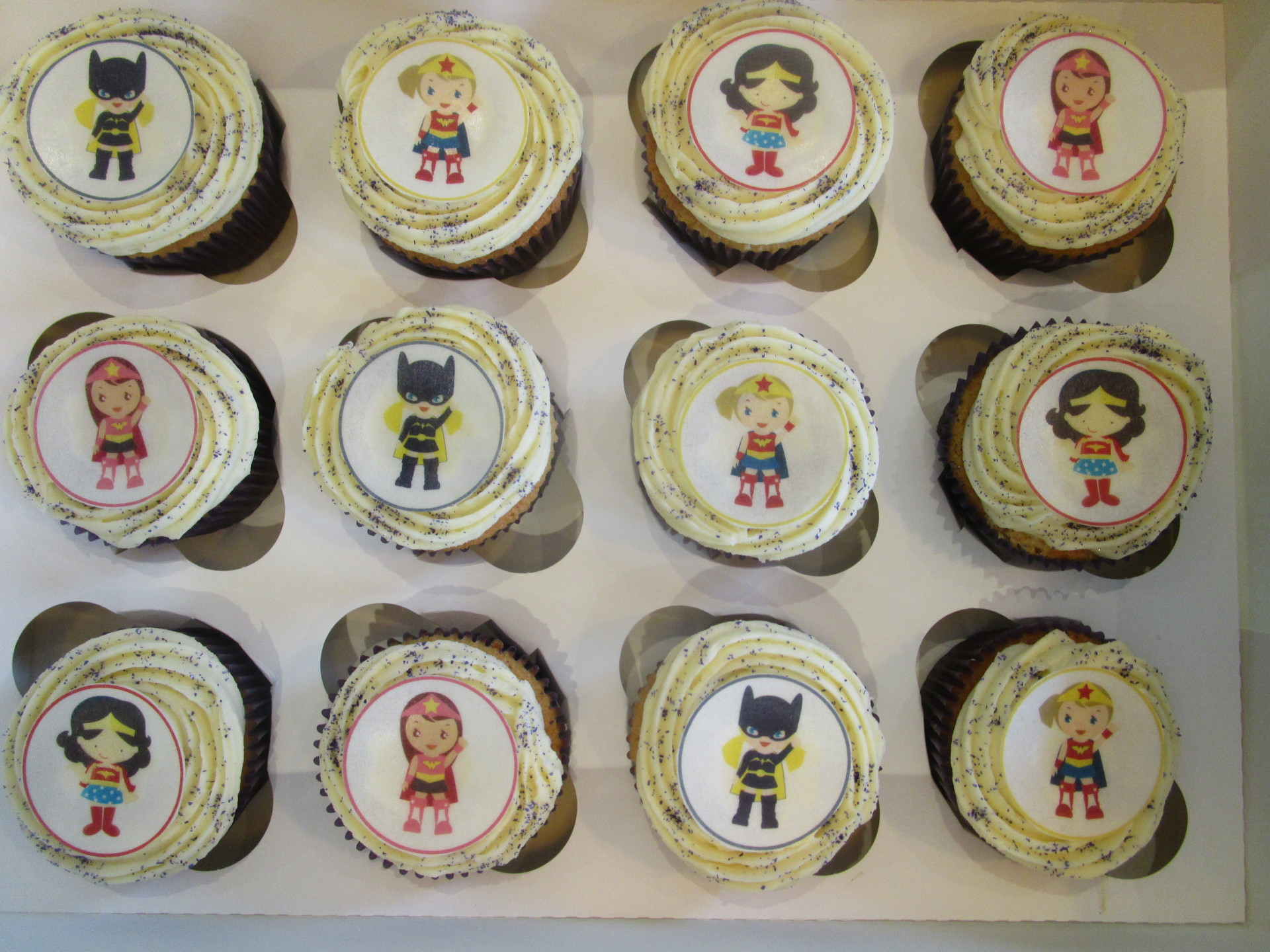 Vanilla Swirl Cupcakes with Edible Glitter and Wafer Superhero Toppers