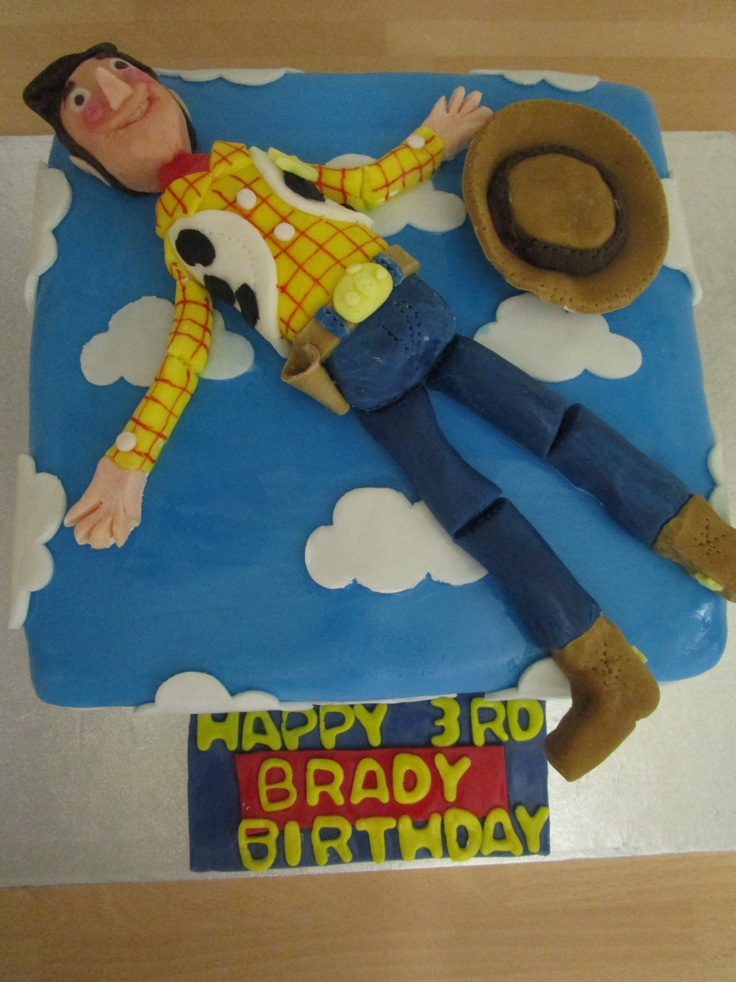 Toy Story Cake with Hand Crafted Edible Woody.