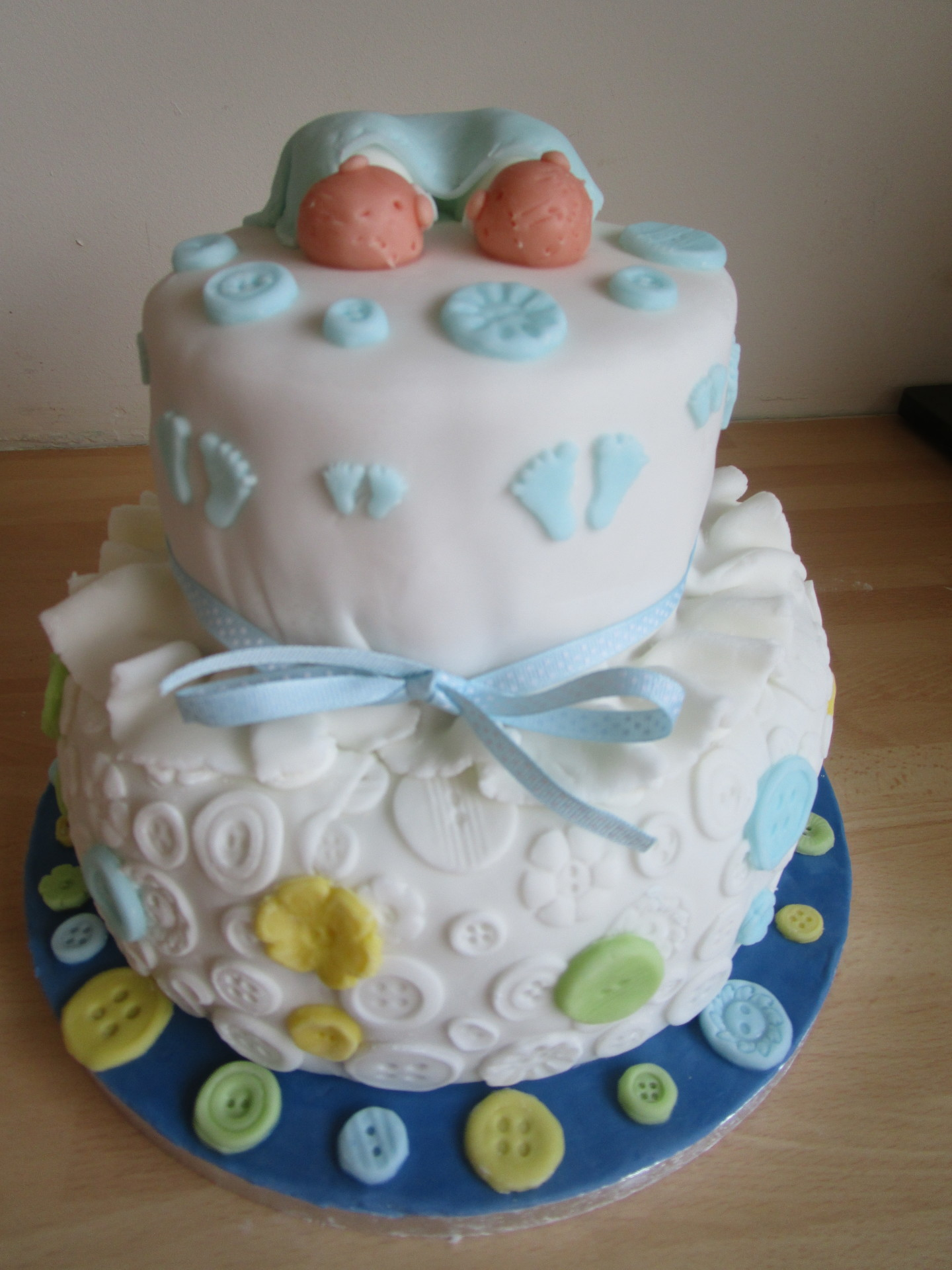 2 tiered Twin Boy Baby Shower Cake with Footprint & Button Design