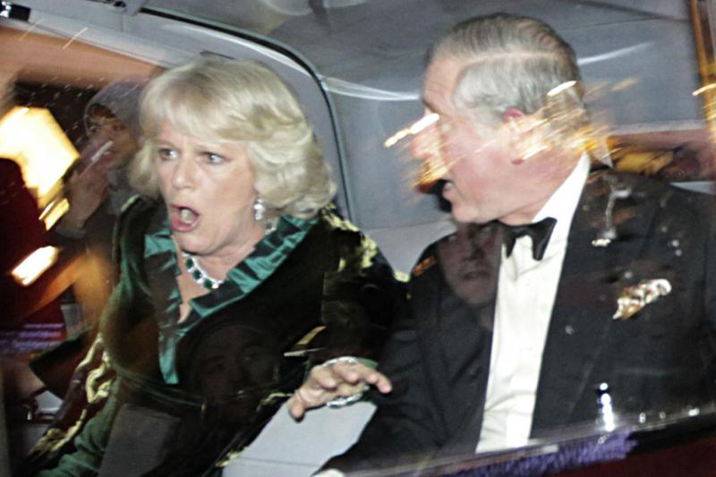The Prince of Wales and the Duchess of Cornwall looking concerned during student protests.
