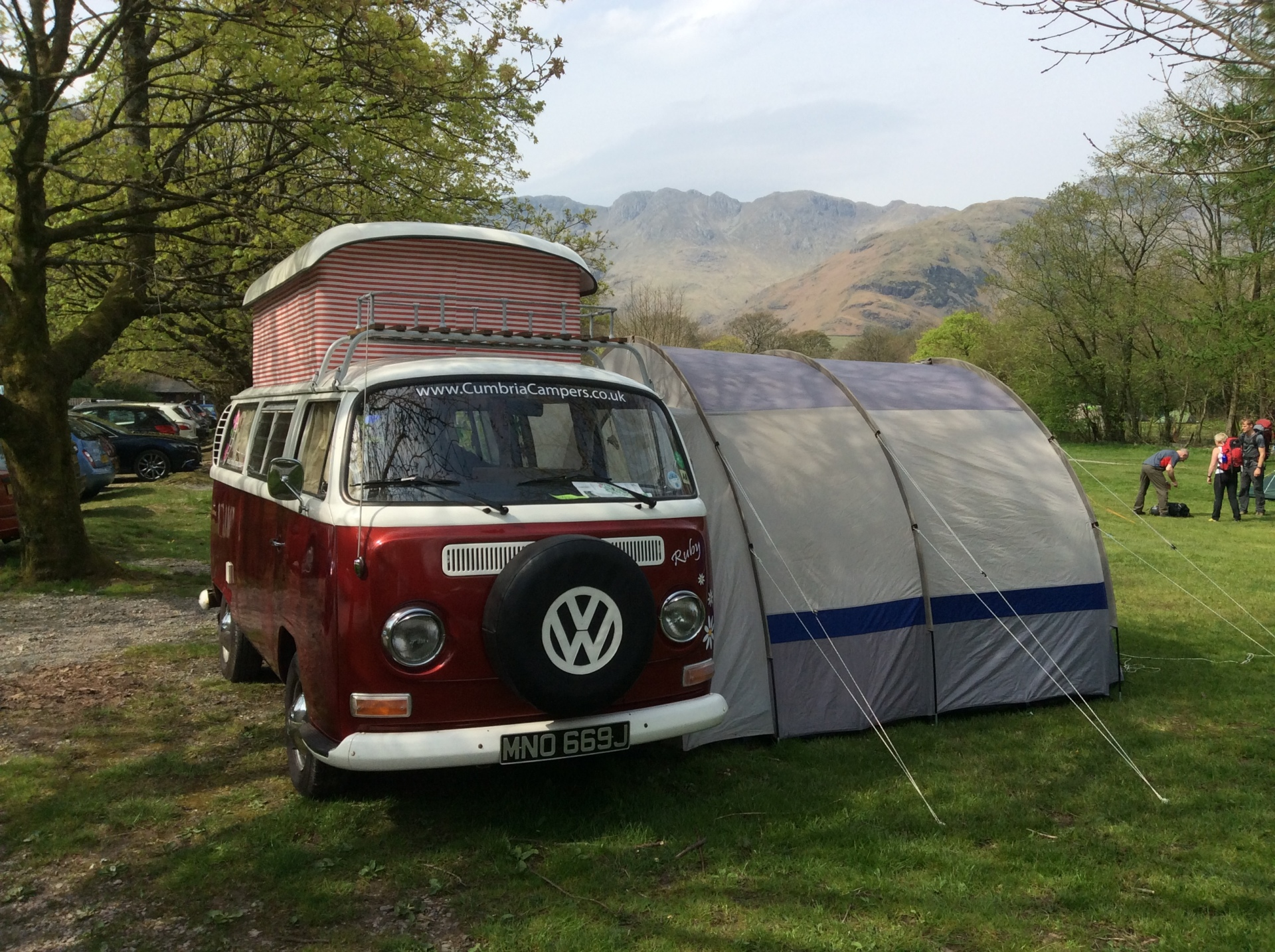 vw camper with pop top and awning, great camping.