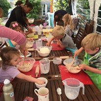 Children's outdoor cookery party making blueberry bites