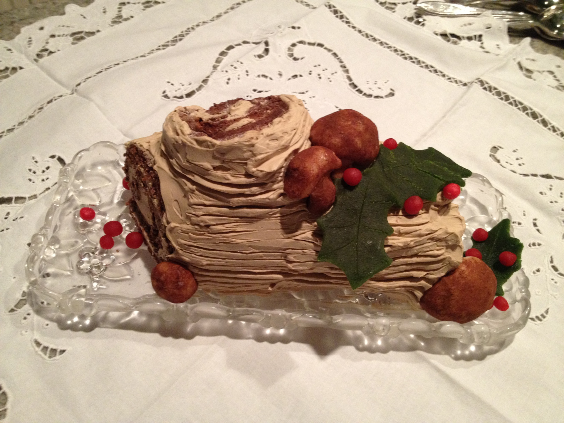 Buche de Noel w/ hand made mushrooms, holly and berries.