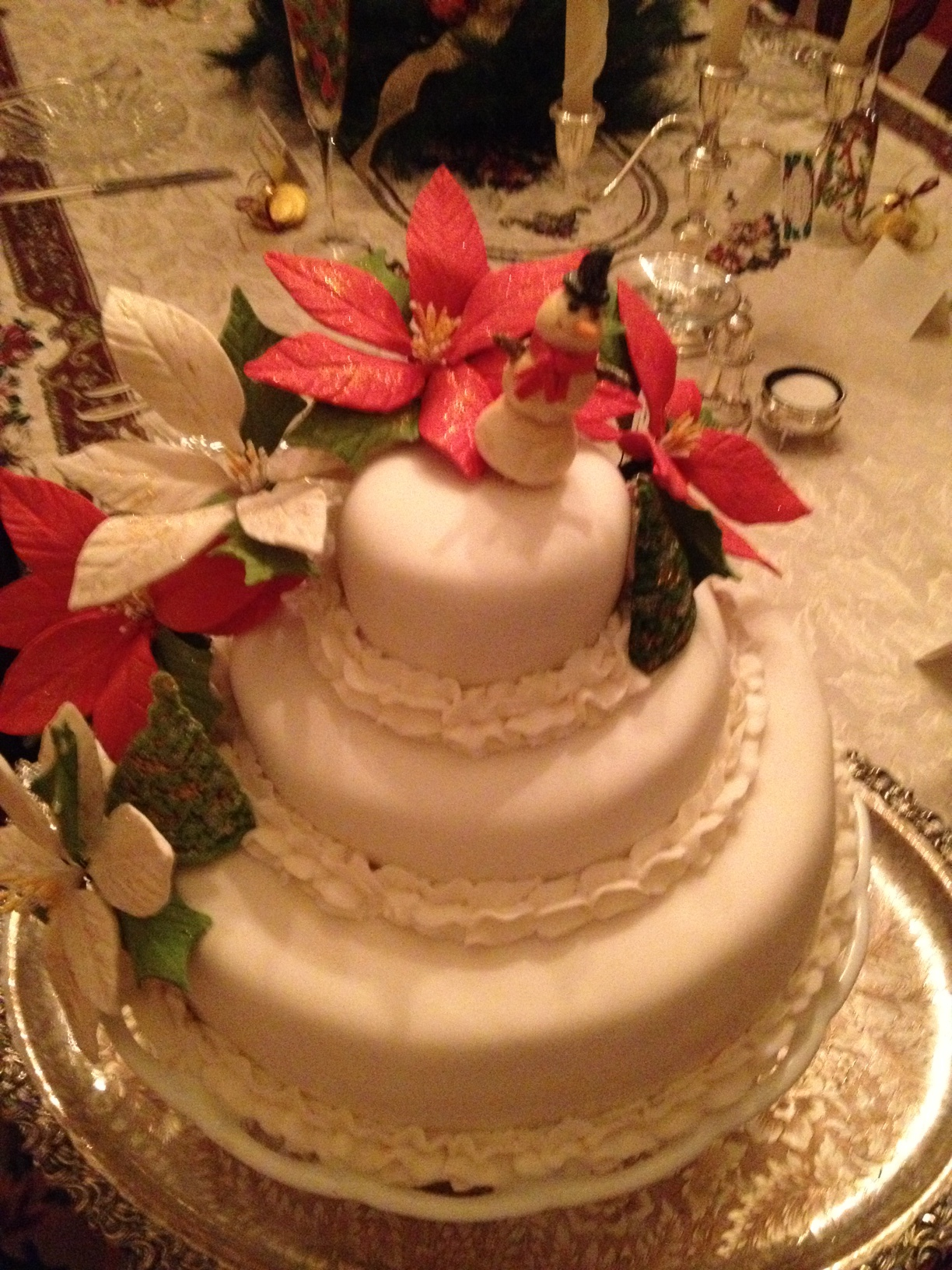 3 Tiered Vanilla Warm Milk Cake covered in White Chocolate Fondant and hand made pointsettias