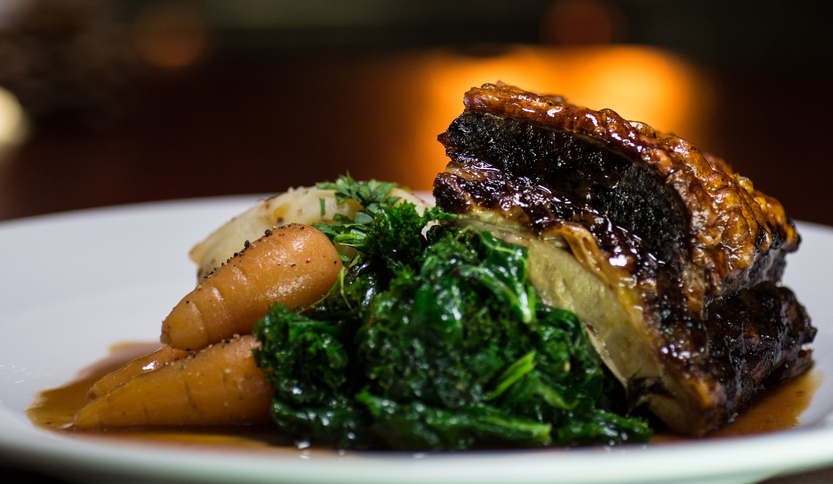 roast pork belly  served with mustard and chive mash, cavalo nero red wine  sage jusand