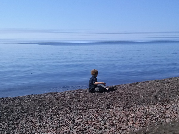 Boy on the north shore beach
