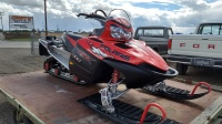 2005 Polaris RMK 900 Red with black on a trailer side view