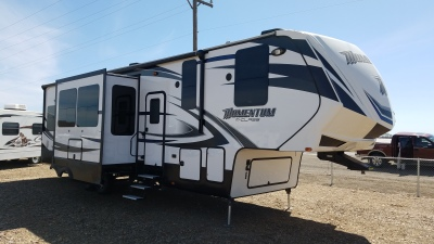 2015 Grand Designs Momentum 5th wheel camper with multi slideouts in mountain home idaho