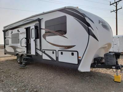 2016 Tan Thor Ais 25.2' Motor Coach with white and blue graphics and multiple slide outs at Terrys Truck and RV in Mountain Home, Idaho