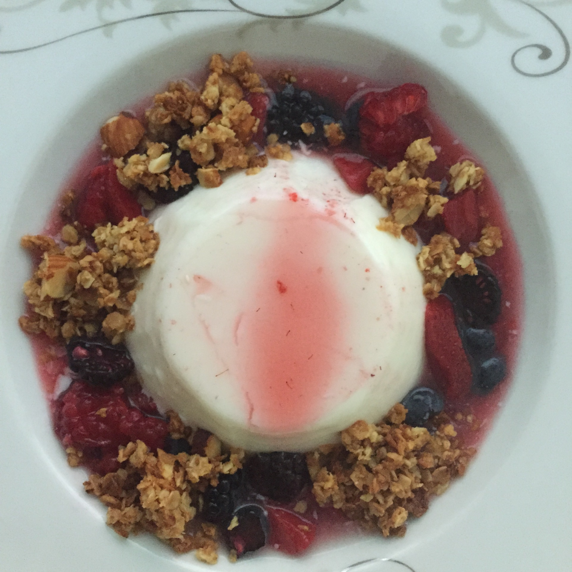 Junket, oat granola, macerated berries.