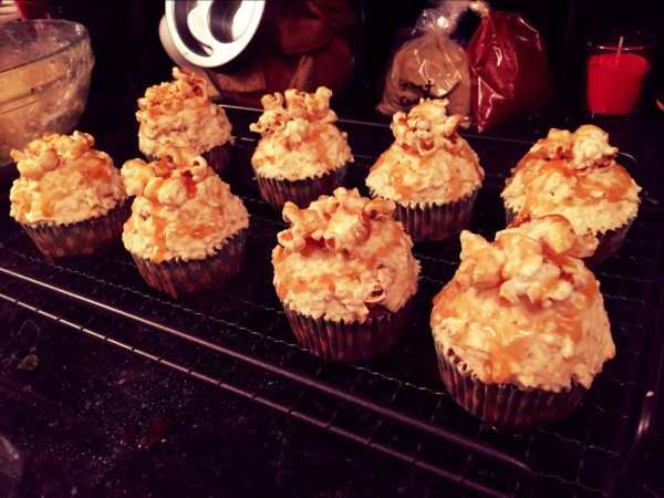 Vanilla cupcakes, popcorn cream cheese frosting, salted caramel sauce