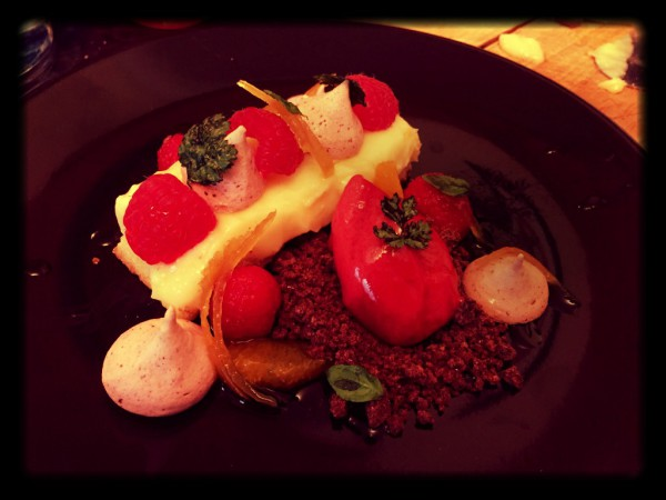 Lemon tart, raspberry sorbet, raspberry meringues, chocolate crumb, candied lemon peel, orange segments