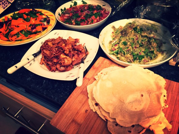 Cassava tortillas, pulled beef, guacamole, salsa, carrot and coriander salad